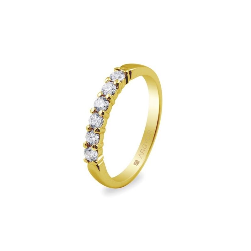 Media alianza de oro con 6 diamantes, con un peso total de 0,39 ct., de Argyor Compromiso.