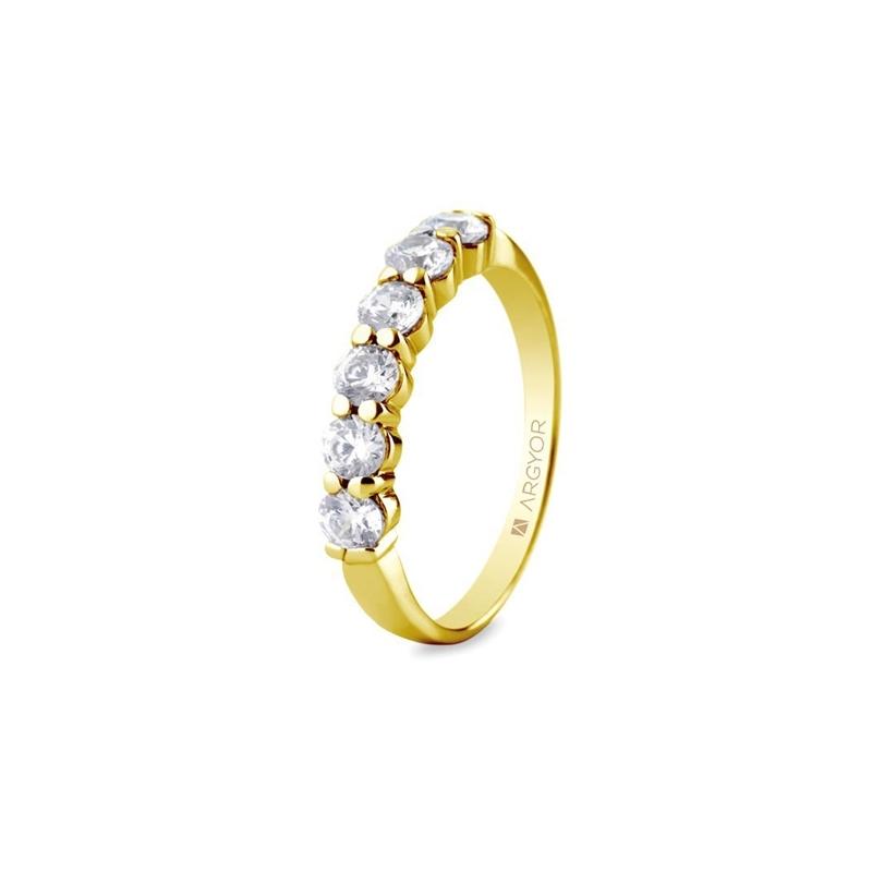 Media alianza de oro amarillo con 6 diamantes y un peso total de 0,60 ct., de Argyor Compromiso.